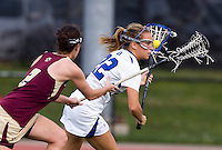 Virginia Crotty (22) of Duke tries to get past Jill Rekart (2) of Boston College during the first round of the ACC Women's Lacrosse Championship in College Park, MD.  Duke defeated Boston College, 17-6.
