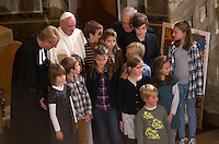 Papa Francesco, posa col pastore Jens-Martin Kruse e un gruppo di bambini, al termine della sua visita alla Chiesa Evangelica Luterana di Roma, 15 novembre 2015.<br /> Pope Francis poses with Rev. Jens-Martin Kruse and a group of children at the end of his visit to the Lutheran Evangelical Church in Rome, 15 November 2015.<br /> UPDATE IMAGES PRESS/Riccardo De Luca<br /> <br /> STRICTLY ONLY FOR EDITORIAL USE