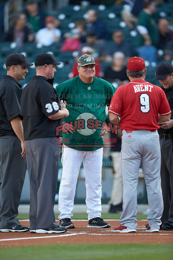 Charlotte 49ers head coach Loren Hibbs meets at home plate with North Carolina State Wolfpack head coach Elliott Avent prior to their NCAA baseball game at BB&T Ballpark on March 29, 2016 in Charlotte, North Carolina. The Wolfpack defeated the 49ers 7-1.  (Brian Westerholt/Four Seam Images)