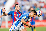 Unai Bustinza (L) of Deportivo Leganes fights for the ball with Paco Alcacer of FC Barcelona during their La Liga match between Deportivo Leganes and FC Barcelona at the Butarque Municipal Stadium on 17 September 2016 in Madrid, Spain. Photo by Diego Gonzalez Souto / Power Sport Images