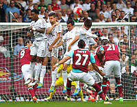 Liroy Fer and Federico Fernandez of Swansea jumps to block Dimitri Payet of West Ham United attempt on goal   during the Barclays Premier League match between West Ham United and Swansea City  played at Boleyn Ground , London on 7th May 2016