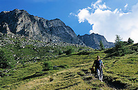 Female hiker descending a mountain.