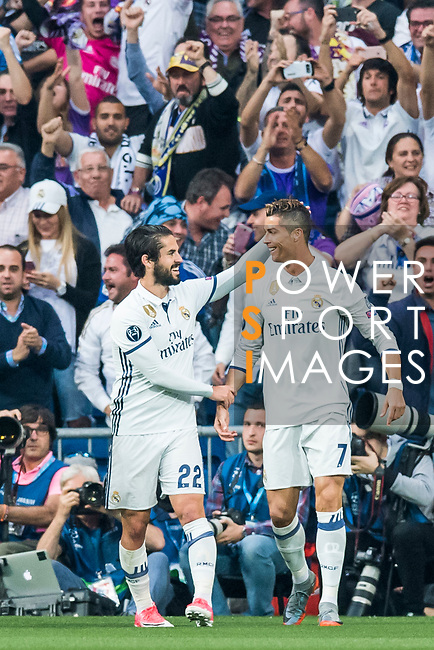 Cristiano Ronaldo of Real Madrid celebrates scoring with teammate Isco Alarcon during their 2016-17 UEFA Champions League Semifinals 1st leg match between Real Madrid and Atletico de Madrid at the Estadio Santiago Bernabeu on 02 May 2017 in Madrid, Spain. Photo by Diego Gonzalez Souto / Power Sport Images