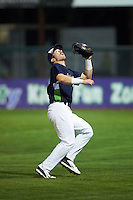 Vermont Lake Monsters first baseman Chris Iriart (18) attempting to catch a pop up in foul territory during a game against the Hudson Valley Renegades on September 3, 2015 at Centennial Field in Burlington, Vermont.  Vermont defeated Hudson Valley 4-1.  (Mike Janes/Four Seam Images)