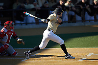 Michael Ludowig (22) of the Wake Forest Demon Deacons follows through on his swing against the Gardner-Webb Runnin' Bulldogs at David F. Couch Ballpark on February 18, 2018 in  Winston-Salem, North Carolina. The Demon Deacons defeated the Runnin' Bulldogs 8-4 in game one of a double-header.  (Brian Westerholt/Four Seam Images)