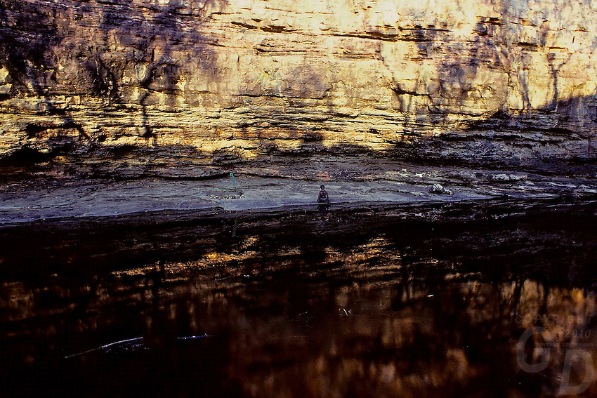 TRIBAL ELDER AT A SACRET SITE FOR THE AUSTRALIAN ABORIGINALS IN ARNHEM LAND, AUSTRALIA