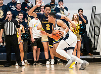 WASHINGTON, DC - FEBRUARY 22: Scott Spencer #2 of La Salle defends against Armel Potter #2 of George Washington during a game between La Salle and George Washington at Charles E Smith Center on February 22, 2020 in Washington, DC.
