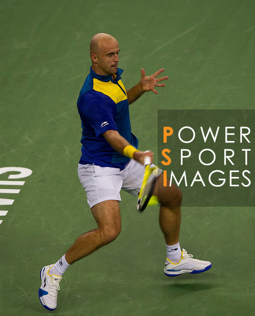 SHANGHAI, CHINA - OCTOBER 13:  Ivan Ljubicic of Croatia returns a ball to Novak Djokovic of Serbia during day three of the 2010 Shanghai Rolex Masters at the Shanghai Qi Zhong Tennis Center on October 13, 2010 in Shanghai, China.  (Photo by Victor Fraile/The Power of Sport Images) *** Local Caption *** Ivan Ljubicic