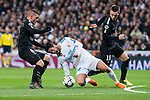 """Real Madrid Francisco Roman """"Isco"""" and PSG Marco Verrati and Giovani Lo Celso during Eight Finals Champions League match between Real Madrid and PSG at Santiago Bernabeu Stadium in Madrid , Spain. February 14, 2018. (ALTERPHOTOS/Borja B.Hojas)"""