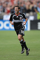 DC United midfielder Ben Olsen (14) celebrates his third goal of the game in the 84th minute. Ben Olsen scored the first hat trick of his career against the NY Red Bulls. DC United defeated the New York Red Bulls, 4-2, at RFK Stadium in Washington DC, Sunday, June 10 , 2007.