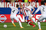 Atletico de Madrid's Fernando Torres (C) and Real Madrid´s Sergio Ramos and Gareth Bale during quarterfinal first leg Champions League soccer match at Vicente Calderon stadium in Madrid, Spain. April 14, 2015. (ALTERPHOTOS/Victor Blanco)