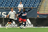 FOXBOROUGH, UNITED STATES - MAY 28: Michel #48 of New England Revolution II passes the ball as Harvey Neville #6 of Fort Lauderdale CF closes during a game between Fort Lauderdale CF and New England Revolution II at Gillette Stadium on May 28, 2021 in Foxborough, Massachusetts.