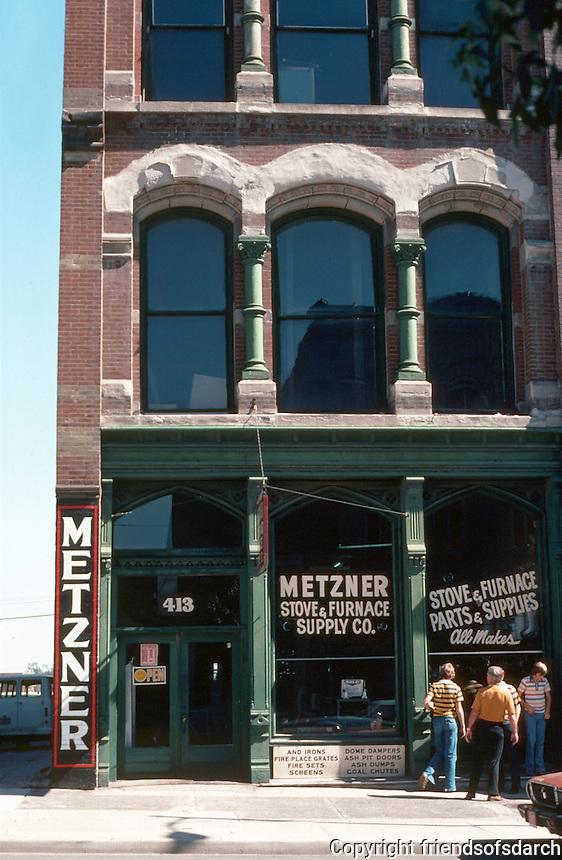 Kansas City:  River Quay area.  Store front.  Ornamentation around windows.