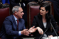 Il Presidente del Senato Piero Grasso parla col Presidente della Camera Laura Boldrini durante la prima seduta comune di senatori e deputati per l'elezione del nuovo Capo dello Stato alla Camera dei Deputati, Roma, 18 aprile 2013..Italian Senate President Pietro Grasso, left, talks to Lower Chamber President Laura Boldrini during the first common plenary session of senators and deputies to elect the new Head of State, at the Lower Chamber in Rome, 18 April 2013..UPDATE IMAGES PRESS/Riccardo De Luca.