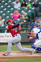 Memphis Redbirds third baseman Pete Kozma (8) follows through on his swing during the second game of a Pacific Coast League doubleheader against the Round Rock Express on August 3, 2014 at the Dell Diamond in Round Rock, Texas. The Redbirds defeated the Express 7-6. (Andrew Woolley/Four Seam Images)
