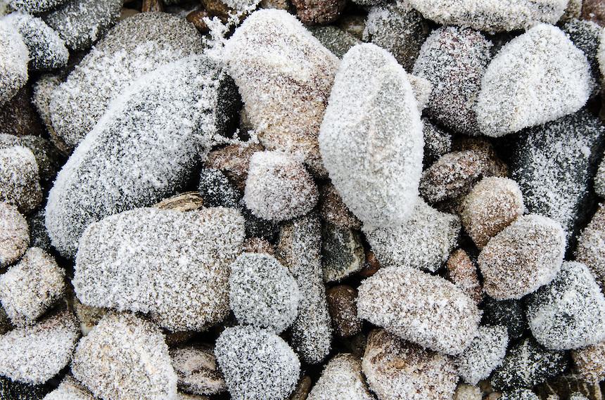 Snow-covered stones from a cold Lake Superior shoreline. Marquette, MI