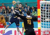 Spain's Valero Rivera Folch (l) and Australia's Kristofer Karlsson during 23rd Men's Handball World Championship preliminary round match.January 15,2013. (ALTERPHOTOS/Acero) /NortePhoto