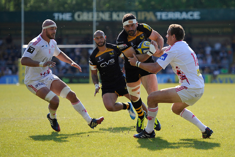 Andrea Masi of London Wasps forces his way past Meyer Bosman of Stade Francais during the first leg of the European Rugby Champions Cup play-off match between London Wasps and Stade Francais at Adams Park on Sunday 18th May 2014 (Photo by Rob Munro)