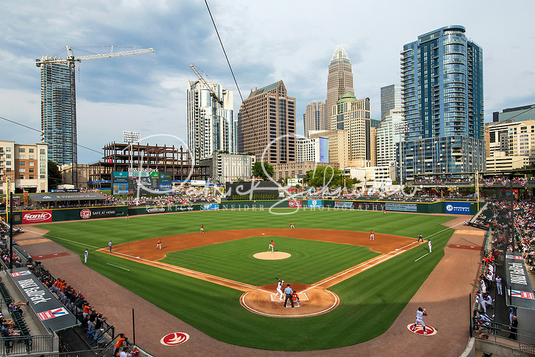 Photography from inside of the BB&T Ballpark view the home plate view looking out into the Charlotte North Carolina skyline, during a Charlotte Knights baseball game. <br /> <br /> Uptown/ downtown Charlotte skyline view from inside of BB&T Ball Park.<br /> <br /> Charlotte Photographer - PatrickSchneiderPhoto.com