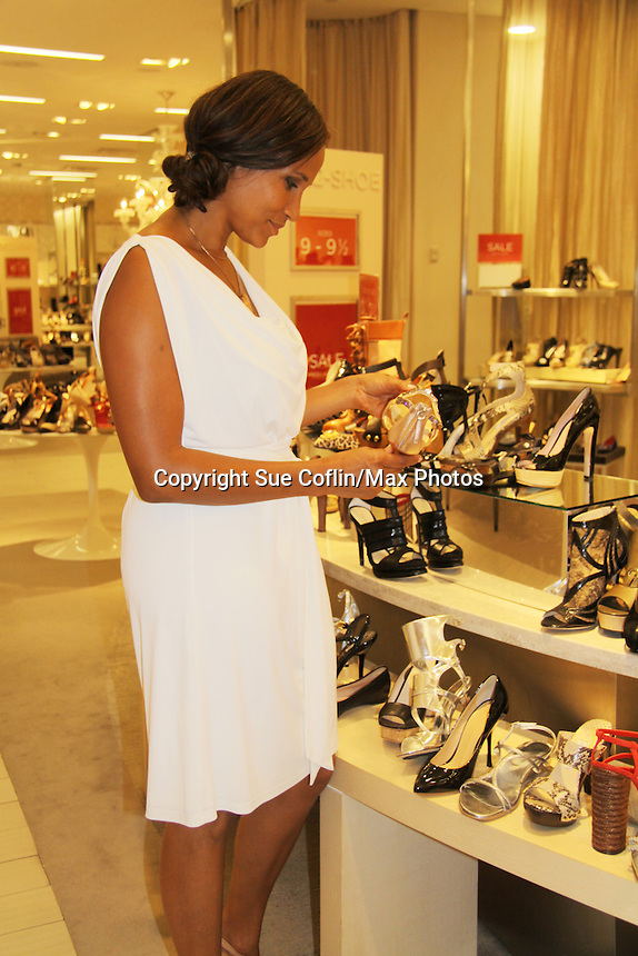 Guiding Light Yvonna Wright checks the shoe selection as a portion of the sales goes to charity as she attends the Innaugural Celebration of Color on Broadway Awards were held on June 8, 2011 at SAKS Fifth Avenue, New York City, New York. The event was held upstairs where beautiful shoes are sold and where a part of the sales this night will benefit OPUS 118 Harlem's School of Music. (Photo by Sue Coflin/Max Photos)