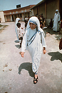 """Calcutta, India. April 04, 1975.<br /> Mother Teresa walking from building to building inside her Kalighat Home for the Dying in Calcutta. The first Home for the Dying opened in 1952 and was a free hospice for the poor. Mother Teresa (Agnes Gonxha Boyaxihu) the Roman Catholic, Albanian nun revered as India's """"Saint of the Slums,"""" was awarded the 1979 Nobel Peace Prize."""