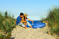 Dad and daughter play in beach sand, Nauset Beach, Cape Cod National Seashore