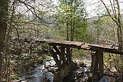Built in the early 1900s, Trestle No. 16 crosses Black Brook along the old East Branch & Lincoln Railroad (1893-1948) in the Pemigewasset Wilderness of Lincoln, New Hampshire. This photo shows how the trestle looked in May 2009.