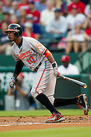 Baltimore Orioles outfielder Adam Jones #10 heads to first base during the Major League Baseball game against the Texas Rangers on August 21st, 2012 at the Rangers Ballpark in Arlington, Texas. The Orioles defeated the Rangers 5-3. (Andrew Woolley/Four Seam Images).