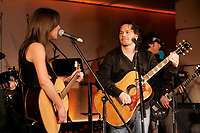 Former Formula One World Champion Jacques Villeneuve launch First Date. ...<br />  his first music album, February 19 2007 at NEWTOWN ; his Montreal nightclub and restaurant.<br /> <br /> He he seen here singing a song  with Quebec artist Amelie Veille.<br /> <br /> photo : Pierre Roussel (c)  Images Distribution