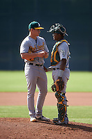 Oakland Athletics pitcher Dustin Driver (45) and catcher Robert Mullen (44) during an instructional league game against the San Francisco Giants on October 12, 2015 at the Giants Baseball Complex in Scottsdale, Arizona.  (Mike Janes/Four Seam Images)