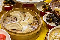 Yangzhou, Jiangsu, China.  Breakfast at Ye Chun Tea House: Steamed Dumplings.  Mushrooms on right.