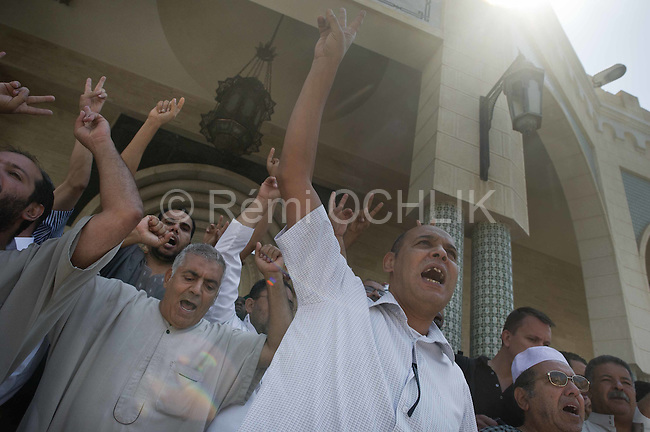 Remi OCHLIK/IP3 PRESS - On august, 26, 2011 In Tripoli - After friday prayer people leave Algeria square mosq celebrating the Tripoli s fall