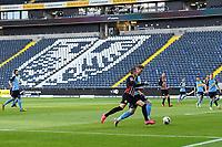 16th May 2020, Commerzbank-Arena, Frankfurt, Germany; Bundesliga football, Eintracht Frankfurt versus Borussia Moenchangladbach;  Players from Eintracht Frankfurt and Borussia Moenchengladbach in front of the empty stands