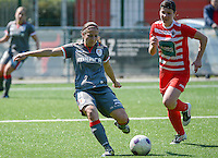 20140419 - ANTWERPEN , BELGIUM : Standard's Vanity Lewerissa pictured scoring the 0-2 lead for Standard  during the soccer match between the women teams of RAFC Antwerp Ladies  and Standard Femina  , on the 24th matchday of the BeNeleague competition on Saturday 19 April 2014 in Deurne .  PHOTO DAVID CATRY