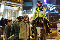 Pictured: A man takes a selfie with a mounted police officer and his horse. Sunday 31 December 2017 and 01 January 2018<br /> Re: New Year revellers in Wind Street, Swansea, Wales, UK