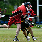 GER - Hannover, Germany, May 30: During the Men Lacrosse Playoffs 2015 match between HTHC Hamburg (black) and DHC Hannover (red) on May 30, 2015 at Deutscher Hockey-Club Hannover e.V. in Hannover, Germany. Final score 17:2. (Photo by Dirk Markgraf / www.265-images.com) *** Local caption *** Philipp Demmer #4 of DHC Hannover, Moritz Spiegel #7 of HTHC Hamburg
