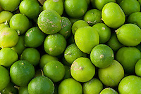 Oman, Green limes for sale in market
