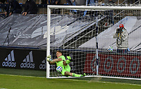 KANSAS CITY, KS - NOVEMBER 22: Tim Melia #29 of Sporting KC stops the second penalty kick from the San Jose Earthquakes before a game between San Jose Earthquakes and Sporting Kansas City at Children's Mercy Park on November 22, 2020 in Kansas City, Kansas.