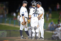 West Michigan Whitecaps Dan Bennett #22 with catcher Zach Maggard #27 and pitching coach Mark Johnson #37 during a game against the Bowling Green Hot Rods at Fifth Third Ballpark on June 26, 2012 in Comstock Park, Michigan.  West Michigan defeated Bowling Green 13-11.  (Mike Janes/Four Seam Images)