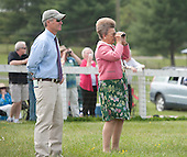 Peggy Steinman watches Glenwood Hurdle from the last jump with with Doug Fout.