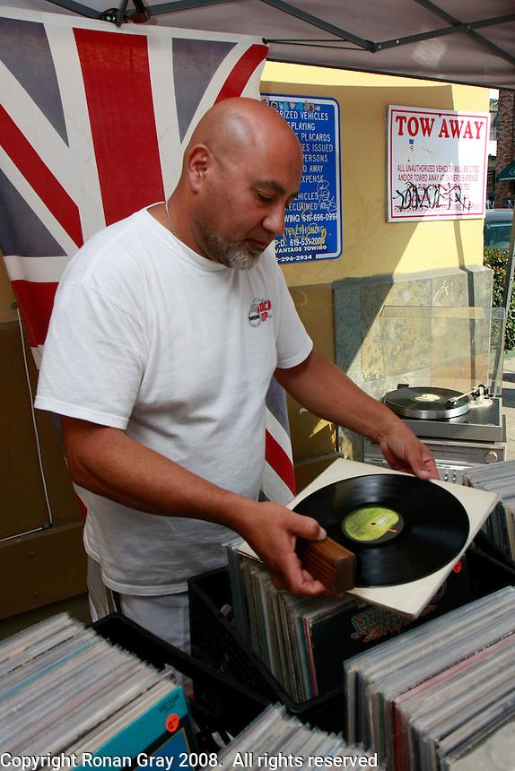 Levon Allen sells LPs at the Ocean Beach open air market off Newport Avenue, Saturday July 12, 2008.
