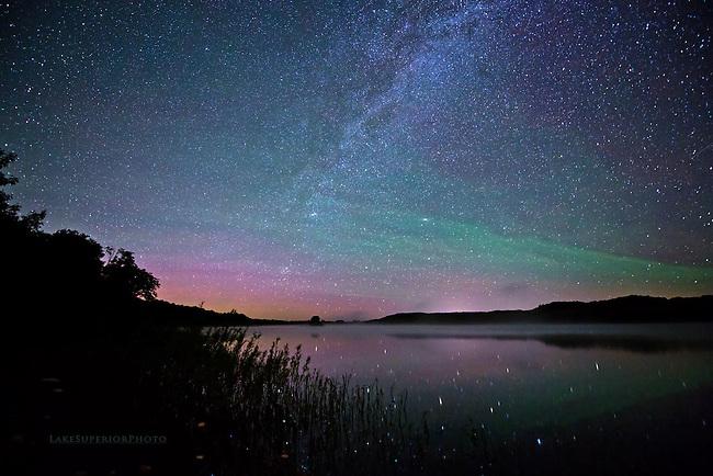 subtle aurora, airglow, milky way, reflecting, off water, in Michigan's Upper Peninsula, Lake Superior