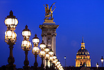 The night view of golden dome of Hotel les Invalides from Alexandre III bridge. Paris. city of Paris. France
