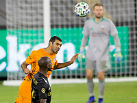 CARSON, CA - OCTOBER 28: Víctor Cabrera #36 of the Houston Dynamo with a headball during a game between Houston Dynamo and Los Angeles FC at Banc of California Stadium on October 28, 2020 in Carson, California.