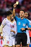 FIFA Referee Ryuji Sato of Japan (R) issues a yellow card to Sayed Redha Isa of Bahrain (L) during the AFC Asian Cup UAE 2019 Round of 16 match between South Korea (KOR) and Bahrain (BHR) at Rashid Stadium on 22 January 2019 in Dubai, United Arab Emirates. Photo by Marcio Rodrigo Machado / Power Sport Images