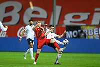 15th November 2020; Leuven, Belgium;  Kevin De Bruyne forward of Belgium challenged by Declan Rice midfielder of England during the UEFA Nations League match group stage final tournament - League A - Group 2 between Belgium and England