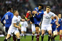 Yoann Huget of France catches the high ball as he is pressurised by Chris Ashton (left) and Owen Farrell of England during the RBS 6 Nations match between England and France at Twickenham on Saturday 23rd February 2013 (Photo by Rob Munro)