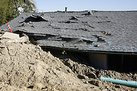A damaged home near the site of the most recent landslide on Mount Soledad, Friday January 18, 2008.