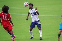 ORLANDO, FL - APRIL 24: Bikel #19 of Vancouver Whitecaps heads the ball during a game between Vancouver Whitecaps and Toronto FC at Exploria Stadium on April 24, 2021 in Orlando, Florida.