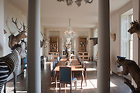 The dining room at Aynhoe Park is a long and elegant space decorated with a collection of hunting trophies